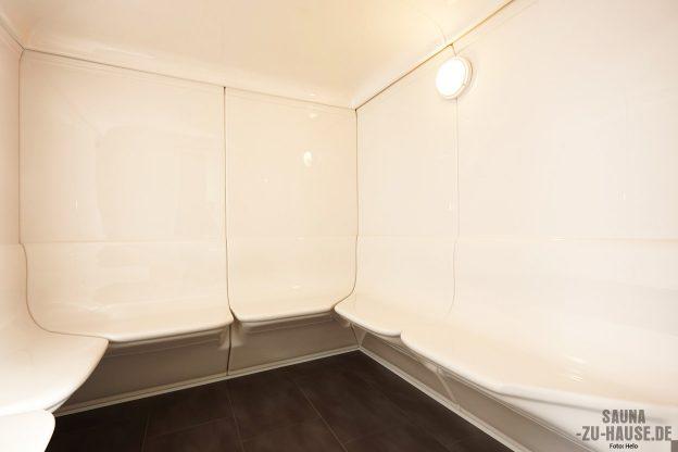 dreamsteam_im-inneren-des-dampfbads-roma-von-helo-herrschen-klarheit-und-design-das-weisse-sanitaer-acryl-glaenzt-dabei-aesthetisch
